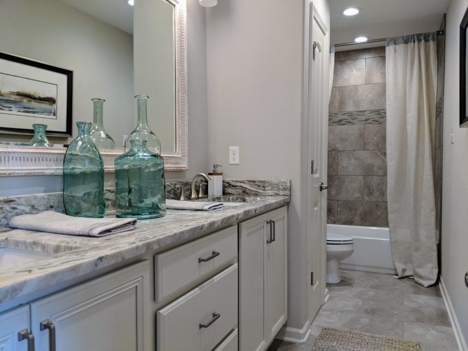 Homes for sales in Memphis area. Upstairs bathroom with double sinks, marble tops.