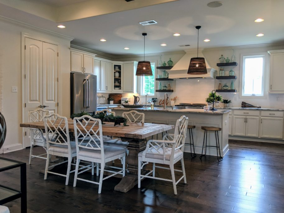 Homes for sales in Memphis area. Kitchen with island and dining area with modern classic style.