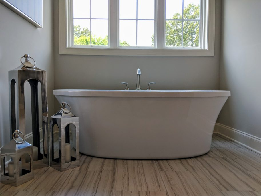Homes for sales in Memphis area. Floating master bathtub with ample light.